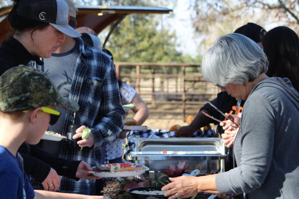 Image of people serving food