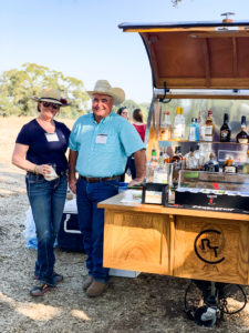Image of man and woman next to a drink cart