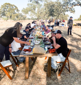 Image of crowd eating at a large table