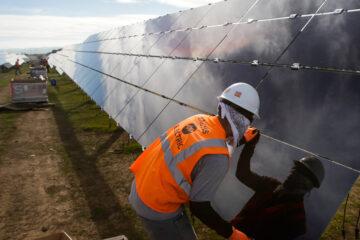 Image of man installing solar panels.