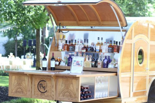 Image of tear drop trailer converted into a bar.